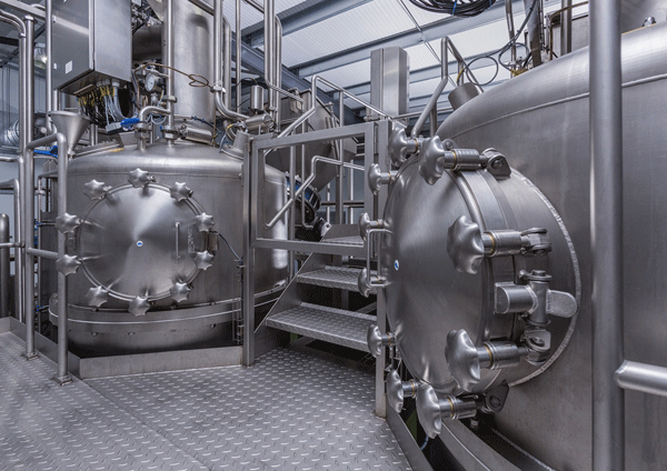 Two 600kg Stainless Steel Vacuum Cooking Vessels on an access platform