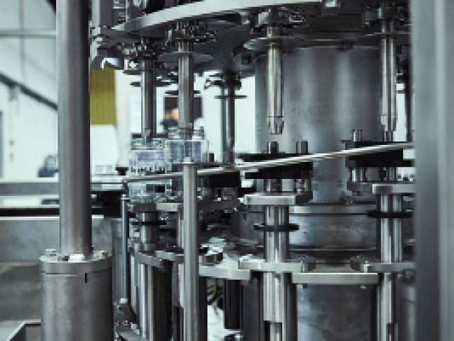 A stainless steel 14 head rotary piston filling machine