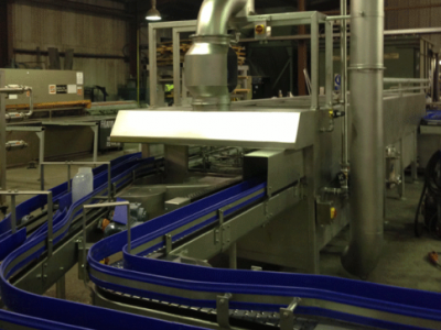 Conveyors Leading to a Container Pasteurising Tunnel